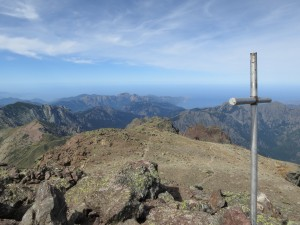 The summit of Paglia Orba, with a view all the way to the West coast. The cross commemorates climbers that have lost their lives on the mountain.