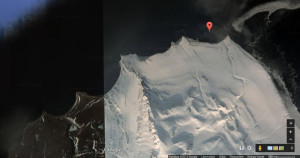 Google captures nicely how abrupt weather can change on Svalbard. The red dot points apprximately towards the Jurassic-Cretaceous boundary of the Festningen profile, with the dino-track-sandstones at the point to the right of it. Note how hard, vertical rock layers continue into the sea.
