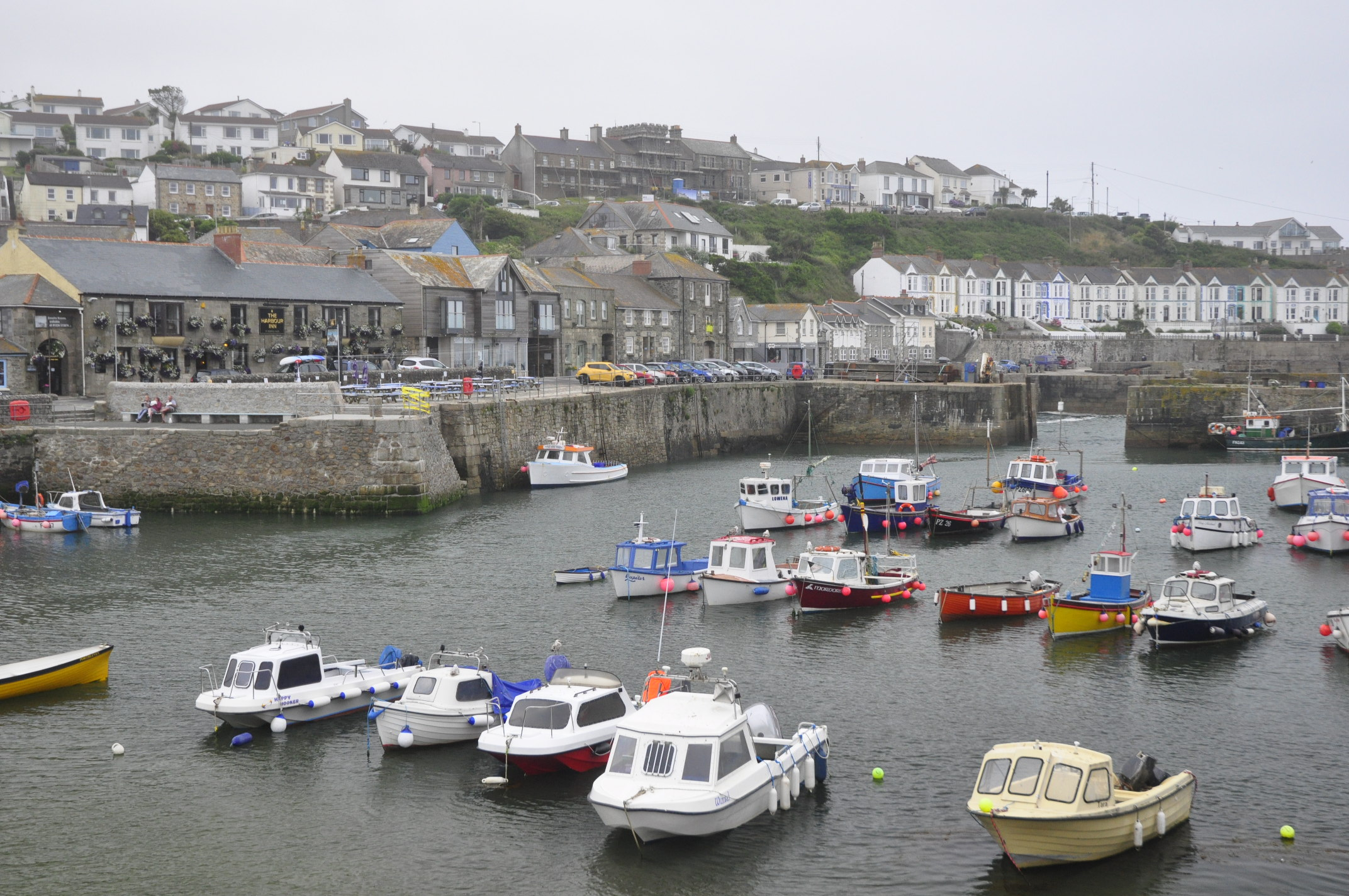 Porthleven harbour, well protected from the wild sea. The Harbour Inn to the left.