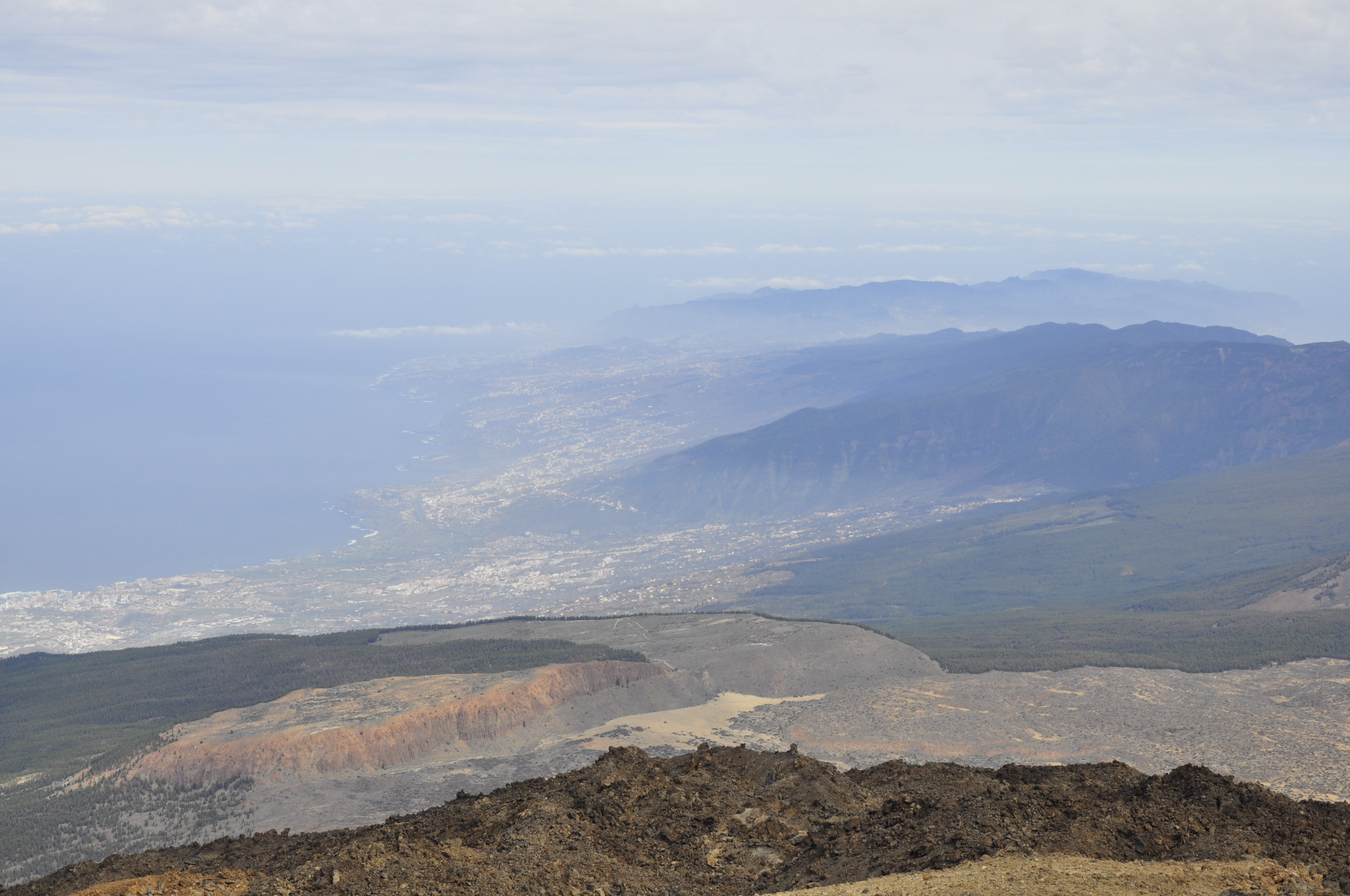 Looking along the North coast of Tenerife, with Puerto de la Cruz near the sea. If Teide should have a large eruption, Puerto de la Cruz is right in the bull's eye, and a reason why Teide is one of the specially watched Decade Volcanoes.