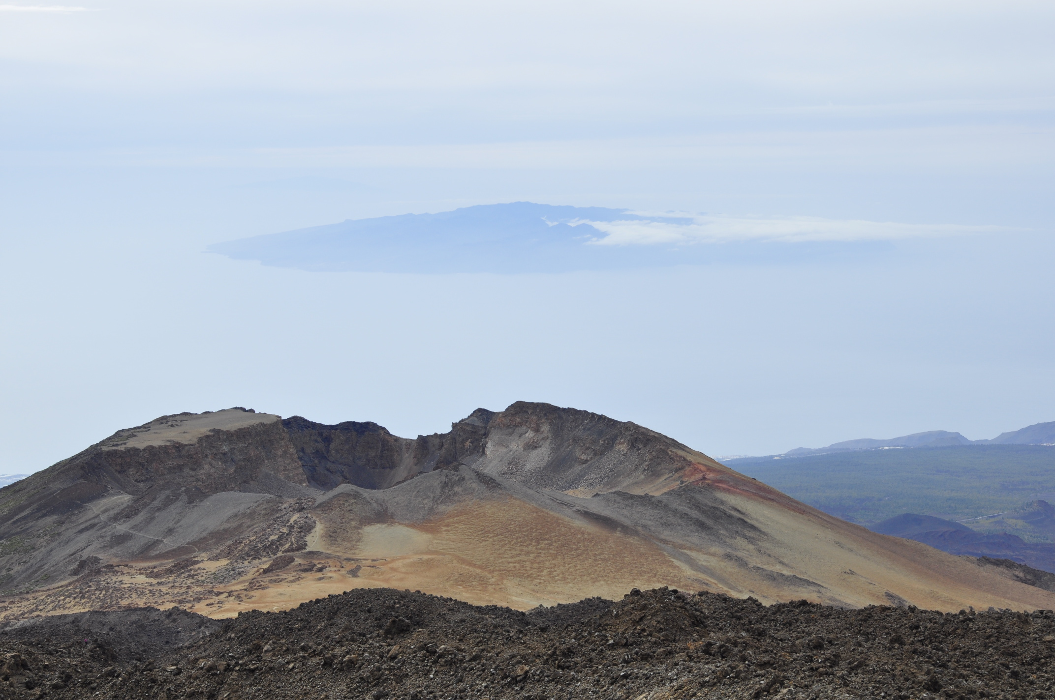 The Pico Viejo crater on Teide's south flank, with La Gomera in the background. Note the big chunk of lava to the left in the crater, the remnant of a lava lake! Four years ago,  I stood on the top of Gomera's highest peak, Alta de Garajonay, looking up onto Teide and decided: I had to go there one day.