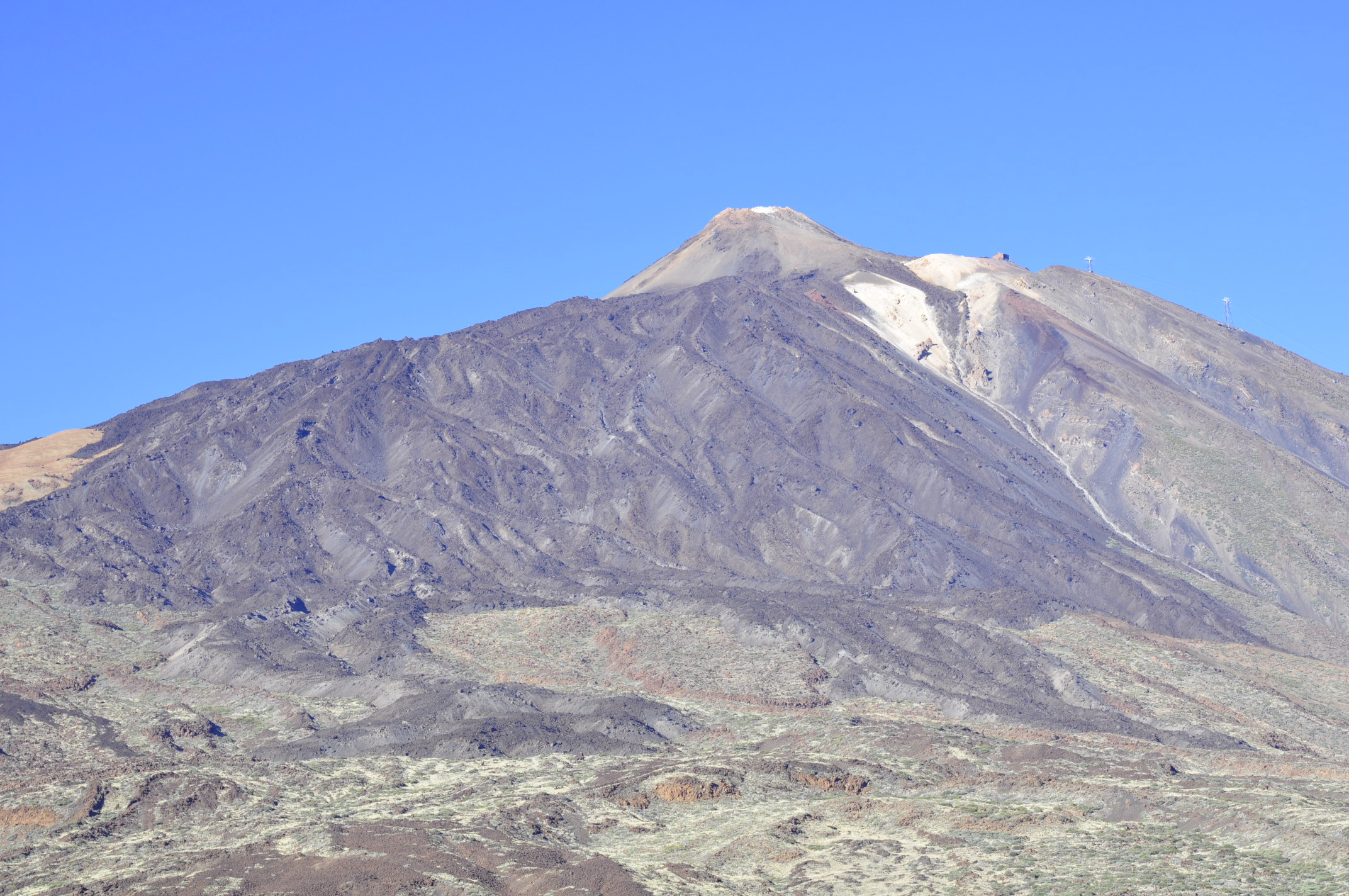 Black lava from Teide's last eruption in 1789, contrasting the older, weathered lava.